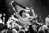 Sylvester Stallone Carried by a Men and Holding a Flag Foto von  Movie Star News