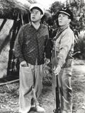Bob Hope standing and Looking Up with Man in Police Uniform Foto von  Movie Star News