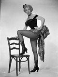 Marlene Dietrich standing One Leg in Black Lingerie with One Leg Stepping on Chair Photo by  Movie Star News