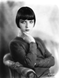 Louise Brooks sitting in Sweater with Hands on Neck Portrait Photo by  Movie Star News