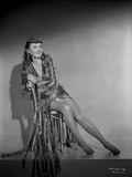 Barbara Stanwyck sitting on Chair in Black and White Portrait Photo by Hal McAlpin