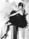 Louise Brooks sitting in Black Dress with Black Heels Photo by  Movie Star News