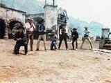 Magnificent Seven Cowboy's Gunfight in Movie Scene Foto af  Movie Star News