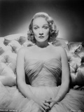 Marlene Dietrich Portrait on a Couch wearing Dress Photo by  Movie Star News