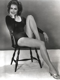 Julie Newmar Siting on Chair in Black Dress Photo by  Movie Star News