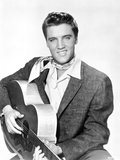 Elvis Presley Seated in Classic with Scarf Photo by  Movie Star News