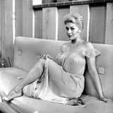 Kim Novak Siting on Bench in White Gown Photo by  Movie Star News