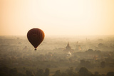 Aerial View of Balloon over Ancient Temples of Bagan at Sunrise in Myanmar Photographic Print by Harry Marx