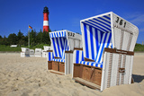 Sylt, Beach Chairs with Lighthouse on the East Beach of Hšrnum Photographic Print by Uwe Steffens