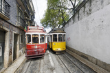 Historical Streetcars in the Alfama District, Lisbon, Portugal Photographic Print by Axel Schmies