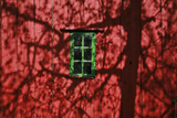 Barn, Red, Green Window, Shadow of a Tree Photographic Print by Uwe Steffens