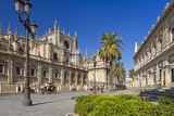 Spain, Andalusia, Seville, Cathedral, Street, Horse-Drawn Carriage Photographic Print by Chris Seba