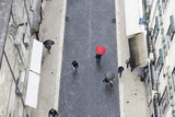 People with Colourful Umbrellas, Vertical View from the Elevador De Santa Justa, Lisbon Photographic Print by Axel Schmies