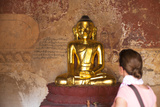 European Tourist Looking at Golden Buddha Statue in Bagan, Myanmar Photographic Print by Harry Marx