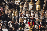 Various Burmese Statues/Masks on Display at Market in Bagan, Myanmar Photographic Print by Harry Marx