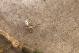 Aerial View of Farmer Working on a Field in Bagan, Myanmar Photographic Print by Harry Marx