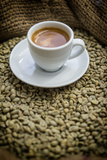 Cup of Espresso on a Sack with Unroasted Coffee Beans Reproduction photographique par Bernd Wittelsbach