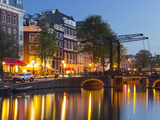 Houses in the Kloveniersburgwal, Lights, Reflexion, in the Evening, Amsterdam, the Netherlands Photographic Print by Rainer Mirau