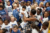 First Lady Michelle Obama Greets Children at Naval Air Station Oceana Summer Camp Photo