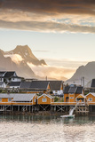Sunset on the Fishing Village Framed by Rocky Peaks and Sea, Sakrisoya, Nordland County Impressão fotográfica por Roberto Moiola
