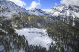 Aerial View of the Alpine Village of Laguzzola Framed by Woods and Snowy Peaks, Spluga Valley Photographic Print by Roberto Moiola