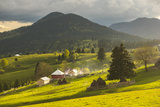 Farm and Haystacks in the Rural Transylvania Landscape at Sunset, Piatra Fantanele, Transylvania Photographic Print by Matthew Williams-Ellis