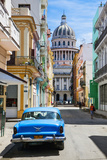 A Classic Car Parked on Street Next to Colonial Buildings with Former Parliament Building Fotografie-Druck von Sean Cooper