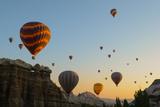 Hot Air Balloons Cruising over Cappadocia, Anatolia, Turkey, Asia Minor, Eurasia Photographic Print by James Strachan