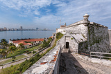 Looking across the Calm Waters of Havana Bay to Havana with the 16th Century Fortress, Morro Castle Photographic Print by Garry Ridsdale