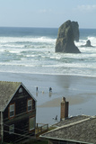 Cannon Beach, Oregon. People Walking with Dog Photo by Natalie Tepper