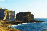 Mediterranean Europe, Malta, Gozo Island, Dwerja Bay, Hikers at Fungus Rock Photographic Print by Christian Kober