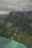 Steep Rocky Cliffs Rise Above the Green Waters of Little Lake Clark Reproduction photographique par Beth Wald