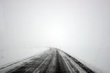 Road During Winter Storm Fotografisk tryk af Raul Touzon