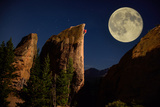 A Climber Ascends a Rock Formation under a Full Moon Near Lily Lake in Estes Park 写真プリント : Keith Ladzinski