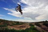A Rider Jumps High in the Air at a Motocross Event Photographic Print by Keith Ladzinski