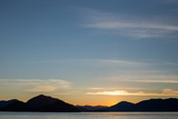 Sunset over the Mountains Within Alaska's Inside Passage Photographic Print by Erika Skogg