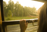 A Woman Looking Through a Train Window, Siberia, Russia Fotografisk tryk af John Burcham