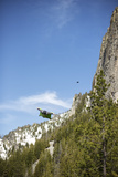 Two Wingsuit Pilots Fly in Close Proximity to a Mountain Lámina fotográfica por Chad Copeland