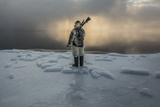 An Inuit Hunter on the Sea Ice Photographic Print by Cristina Mittermeier