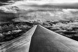 Wing of Airplane Flying in Mid-Air under and Between Clouds Trykk på strukket lerret av Liyun Yu