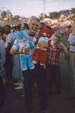 Young Man Holding Stuffed Bears Prizes at a Carnival Game at the Iowa State Fair, 1955 Fotografisk trykk av John Dominis
