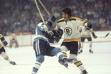 Nhl Boston Bruin Player Derek Sanderson Tripping Pittsburgh Penguin Player During Game Fotografisk tryk af Art Rickerby