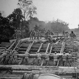 Chinese Engineers Construct a Wooden Bridge by Hand on the Ledo Road, Burma, July 1944 Photographic Print by Bernard Hoffman