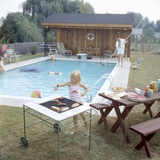 1959: Family Cookout and Enjoying the Backyard Swimming Pool, Trenton, New Jersey Photographic Print by Frank Scherschel