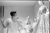 Drinking Guest Looking at a Display at the Met Fashion Ball, New York, New York, November 1960 Photographic Print by Walter Sanders