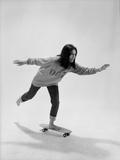 Studio Photos of Gloria Steinem Riding a Skateboard with a 007 James Bond Sweatshirt  1965