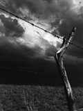 On a Small Farm, Ominous Clouds Overhead, Outlined by Barbed Wire Fencing Reproduction photographique par Nat Farbman