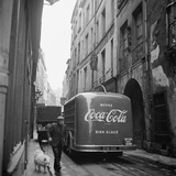 A Man Walks His Dog Beside a Bus with Coca Cola Advertisement, France, 1950 Photographic Print by Mark Kauffman