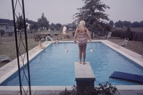 1959: Susan in Diving Stance During a Family Cookout, Trenton, New Jersey Photographic Print by Frank Scherschel