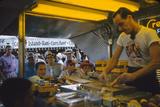 In a Booth at the Iowa State Fair, a Man Demonstrates 'Feemsters Famous Vegetable Slicer', 1955 Fotografisk trykk av John Dominis